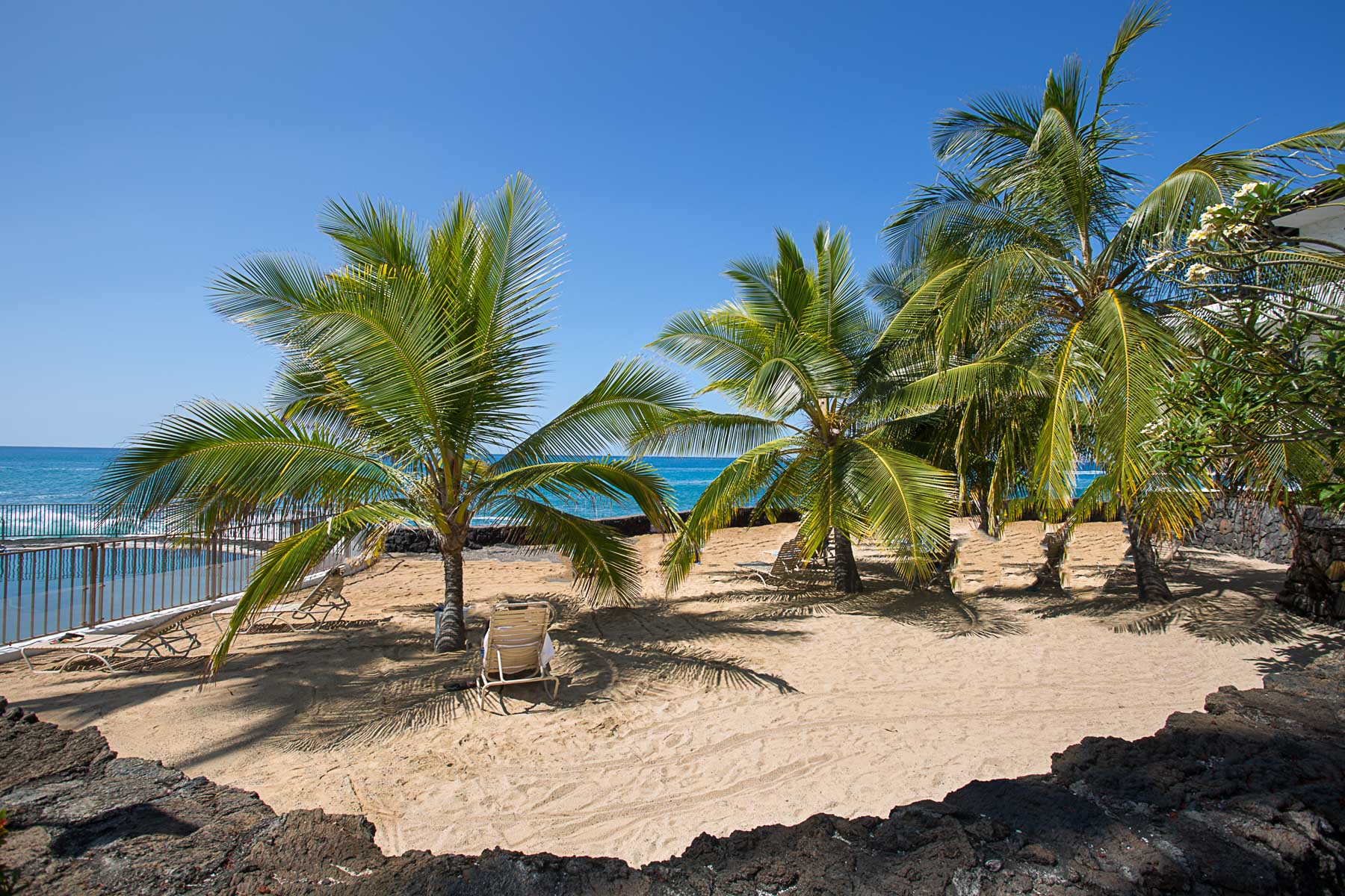 Private sand sunning area adjacent to your condo